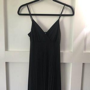 Black pleated v-neck dress